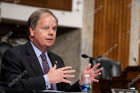 Sen. Doug Jones, D-Ala., questions witnesses during a Senate Senate Health, Education, Labor, and Pensions Committee Hearing on the federal government response to COVID-19 on Capitol Hill, in Washington
