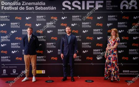 Stock Photo of British film director Harry Macqueen (L) and producers Tristan Goligher (C) and Emily Morgan pose during the presentation of their film 'Supernova' as part of the 68th edition of the San Sebastian International Film Festival, in San Sebastian, Spain, 23 September 2020.