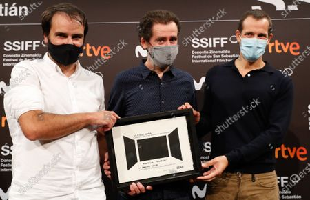 Spanish film directors and script writers Aitor Arregi, Jon Garano and Jose Mari Goenaga pose with the VI EZAE Award for his film 'La Trinchera Infinta' (lit. 'The Never Ending Trench') during the 68th edition of the San Sebastian International Film Festival, in San Sebastian, Spain, 23 September 2020.