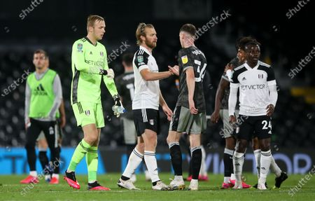 Goalkeeper Marek Rodak of Fulham & Tim Ream of Fulham bump fists with Ciaran Brennan of Sheffield Wednesday after the match