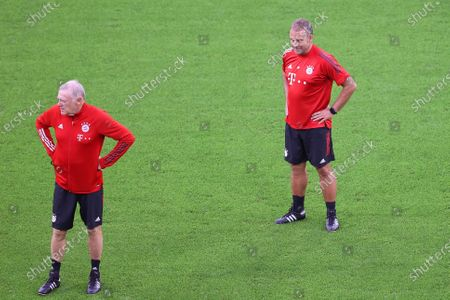 Bayern Munich's head coach Hansi Flick (R) and assistant coach Hermann Gerland (L) lead their team's training session at the Puskas Arena in Budapest, Hungary, 23 September 2020. Champions League winner Bayern Munich will face Europa League winner Sevilla FC in the UEFA Super Cup match on 24 September 2020.
