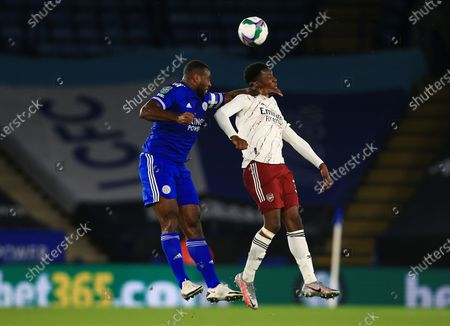 Wes Morgan of Leicester City and Eddie Nketiah of Arsenal