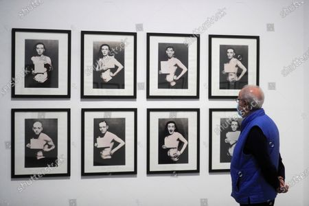 A man looks at photographs taken by Carla Sozzani, on display as part of an exhibition, titled 'Between Art and Fashion. Photographs from the Collection of Carla Sozzani' at the CentroCentro Cibeles in Madrid, Spain, 23 September 2020. The exhibition featuring works from the photography collection of Italian book and magazine editor, gallerist, and businesswoman Carla Sozzani runs from 23 September 2020 to 10 January 2021.