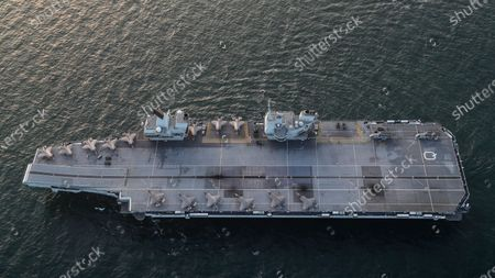 A handout picture provided by the British Ministry of Defence shows fighter jets on board the HMS Queen Elizabeth at Sea en route to North East Scotland, 22 September 2020 (issued 23 September 2020). This month's Group Exercise (GROUPEX) will see HMS Queen Elizabeth joined by warships from the UK, US and the Netherlands, which will accompany HMS Queen Elizabeth on her first global deployment in 2020. The newly formed Carrier Strike Group will be put through its paces off the North East coast of Scotland as part of Joint Warrior, NATO's largest annual exercise.