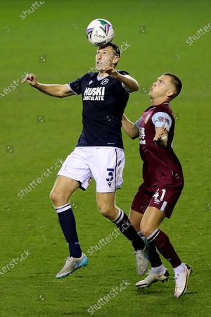 Stock Photo of Millwall's Murray Wallace shows his skills as Josh Benson of Burnley looks on during Millwall vs Burnley, Caraboa Cup Football at The Den on 23rd September 2020