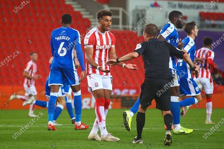 Jacob Brown of Stoke City (18) speaks to David Webb Referee about a decision during the EFL Cup match between Stoke City and Gillingham at the Bet365 Stadium, Stoke-on-Trent