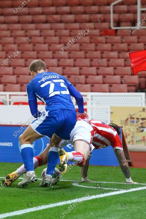 Stock Image of Steven Fletcher of Stoke City (21) is fouled by Henry Woods of Gillingham (23) during the EFL Cup match between Stoke City and Gillingham at the Bet365 Stadium, Stoke-on-Trent