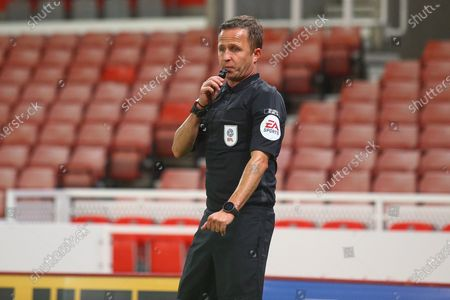 Stock Photo of David Webb Referee blowing the whistle during the EFL Cup match between Stoke City and Gillingham at the Bet365 Stadium, Stoke-on-Trent