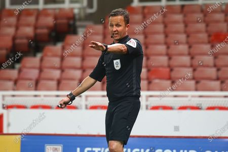 Stock Picture of David Webb Referee gesturing during the EFL Cup match between Stoke City and Gillingham at the Bet365 Stadium, Stoke-on-Trent
