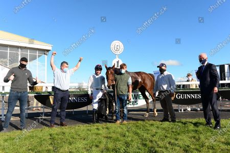 LISTOWEL 23-September-2020. Guinness Kerry National. CABARET QUEEN and Paul Townend win for owners Syndicates Racing with Jonathan O'Grady and Gearoid Sheehan on left, grooms John Clifford and Ben Delmar and trainer Willie Mullins all on right.