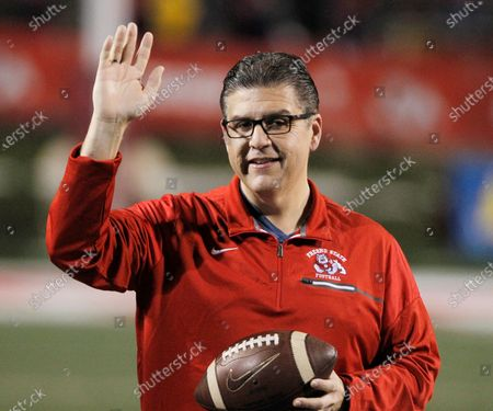 Fresno State president Joseph I. Castro waves to the crowd before an NCAA college football game against BYU in Fresno, Calif. Castro was chosen to be the new chancellor of the California State University, becoming the first Mexican-American and native Californian to lead the nation's largest four-year public university system. The CSU Board of Trustees announced the appointment of Castro on . He will replace Chancellor Timothy White, who is retiring