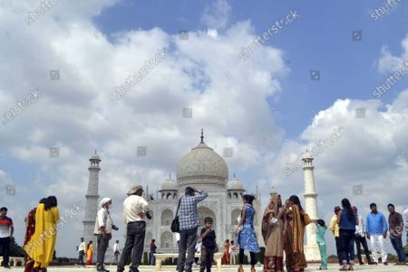 Stock Image of People visit the Taj Mahal in Agra, India, Sept. 23, 2020.   India's iconic monument of love - Taj Mahal, which was closed on March 17 amid the COVID-19 pandemic, was reopened Monday to tourists, officials said.