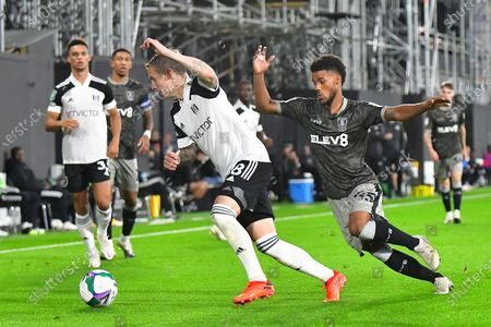 Stefan Johansen, Elias Kachunga during the EFL Cup match between Fulham and Sheffield Wednesday at Craven Cottage, London