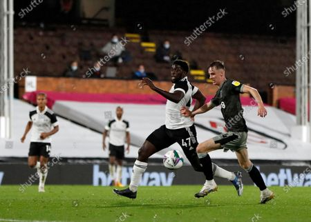 Stock Photo of Fulham's Aboubakar Kamara, left, duels for the ball with Sheffield Wednesday's Ciaran Brennan during the English League Cup soccer match between Fulham and Sheffield Wednesday at the Craven Cottage stadium in London