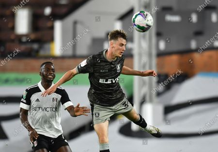 Sheffield Wednesday's Ciaran Brennan, right, duels for the ball with Fulham's Neeskens Kebano during the English League Cup soccer match between Fulham and Sheffield Wednesday at the Craven Cottage stadium in London