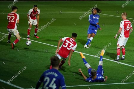 Everton's Alex Iwobi, center right, scores his side's third goal during the English League Cup third round soccer match between Fleetwood Town and Everton at the Highbury Stadium in Fleetwood, England
