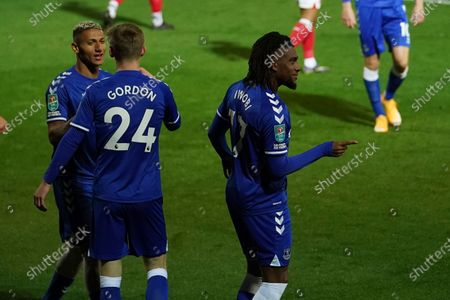Everton's Alex Iwobi, right, celebrates after scoring his side's third goal during the English League Cup third round soccer match between Fleetwood Town and Everton at the Highbury Stadium in Fleetwood, England