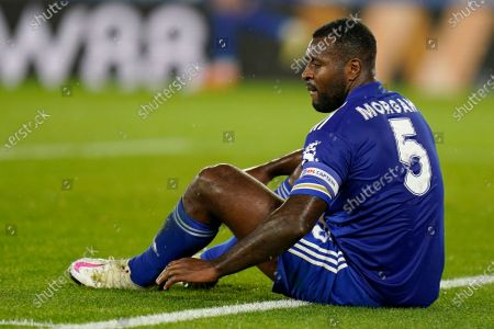 Leicester's Wes Morgan reacts after his team conceded an own goal during the English League Cup 3rd round soccer match between Leicester City and Arsenal at the King Power Stadium in Leicester, England