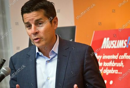 Stock Photo of Muslim comedian Dean Obeidallah speaks at a news conference in New York. A federal judge awarded Muslim-American radio host Dean Obeidallah $4.1 million in monetary damages after he successfully sued a neo-Nazi website operator who falsely accused him of terrorism