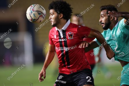 Al Ahly's Mahmoud Kahraba (R) in action against Masr's Alaa Atta (L) during the Egyptian Premier League soccer match between FC Masr and Al Ahly SC in Cairo, Egypt, 23 September 2020.