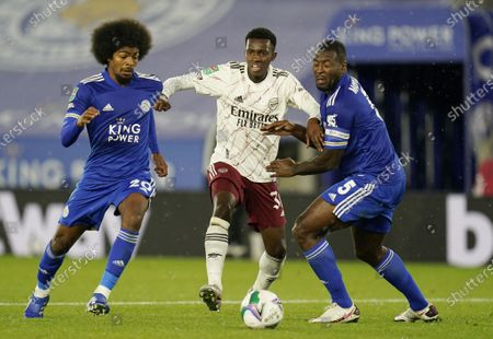 Hamza Choudhury (L) and Wes Morgan (R) of Leicester in action against Eddie Nketiah of Arsenal during the English Carabao Cup third round match between Leicester City and Arsenal London in Leicester, Britain, 23 September 2020.