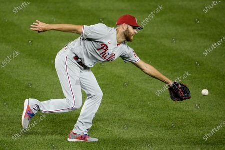 Philadelphia Phillies starting pitcher Zack Wheeler chases a ball during a baseball game against the Washington Nationals, in Washington
