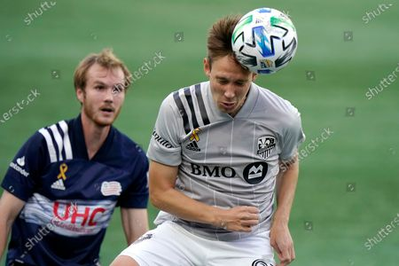 Stock Photo of Montreal Impact's Lassi Lappalainen, right, heads the ball as New England Revolution's Henry Kessler, left, pursues during the first half of an MLS soccer match, in Foxborough, Mass