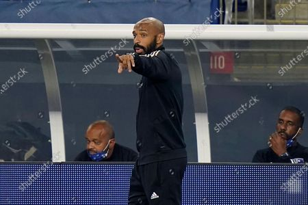 Montreal Impact head coach Thierry Henry, center, shouts from the bench during the second half of an MLS soccer match against the New England Revolution, in Foxborough, Mass