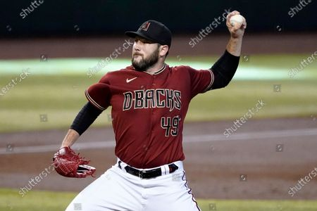 Arizona Diamondbacks starting pitcher Alex Young throws during the first inning of a baseball game against the Texas Rangers, in Phoenix