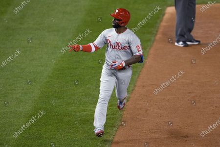 Philadelphia Phillies' Andrew McCutchen celebrates his home run during the eighth inning of the team's baseball game against the Washington Nationals, in Washington
