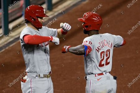 Philadelphia Phillies' Andrew McCutchen (22) celebrates his home run with Bryce Harper during the eighth inning of the team's baseball game against the Washington Nationals, in Washington