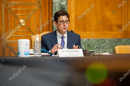 Congressional Budget Office Director Phillip Swagel, PhD, appears before a Senate Committee on the Budget hearing to examine the Congressional Budget Office's updated budget outlook in the Dirksen Senate Office Building on Capitol Hill in Washington, DC., Wednesday, September 23, 2020.