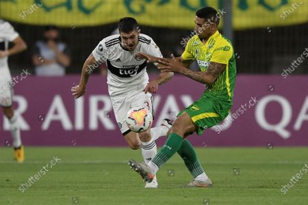 Defensa y Justicia's Héctor David Martínez (R) vies for the ball against Alejandro Silva Gonzalez (L) of Olimpia, during a match of Group G of the Copa Libertadores, between Argentine Defensa y Justicia and Club Olimpia of Paraguay, in Florencio Varela, Argentina, 23 September 2020.