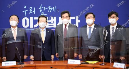 (L-R) South Korea's Finance Minister Hong Nam-ki, Prime Minister Chung Sye-kyun, ruling Democratic Party chief Lee Nak-yon, the party's floor leader Kim Tae-nyeon and Presidential Chief of Staff for Policy Kim Sang-jo pose for a photo during a ruling party-government-presidential office meeting at the National Assembly in Seoul, South Korea, 24 September 2020.