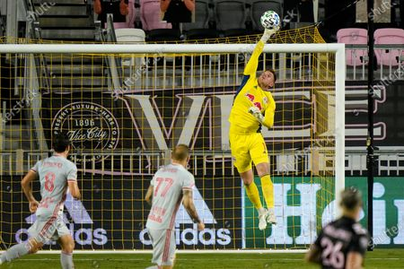 New York Red Bulls goalkeeper David Jensen makes a save during the second half of an MLS match against Inter Miami, in Fort Lauderdale, Fla