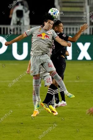 New York Red Bulls forward Brian White, left, and Inter Miami midfielder Victor Ulloa, right, go for the ball during the first half of an MLS match, in Fort Lauderdale, Fla