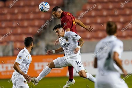 Real Salt Lake defender Donny Toia, right, and Los Angeles Galaxy forward Cristian Pavon, left, battle for the ball in the first half during an MLS match, in Sandy, Utah