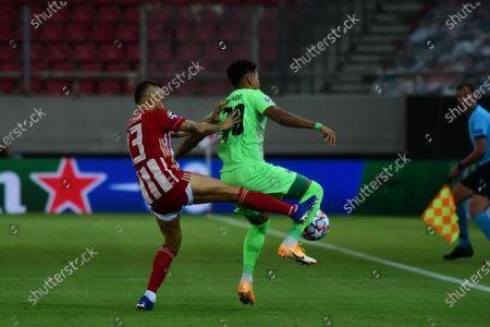 Rafinha (no 13) of Olympiacos tries to stop the effort of Thiago (no 70) of Omonoia.