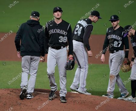 Colorado Rockies starting pitcher Ryan Castellani (38) is removed by manager Bud Black, left, during the fifth inning against the San Francisco Giants in a baseball game, in San Francisco