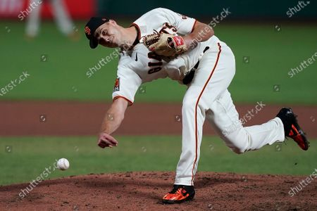 San Francisco Giants relief pitcher Tyler Rogers throws to a Colorado Rockies batter during the seventh inning of a baseball game, in San Francisco
