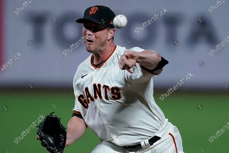San Francisco Giants relief pitcher Tony Watson throws to a Colorado Rockies batter during the eighth inning of a baseball game, in San Francisco