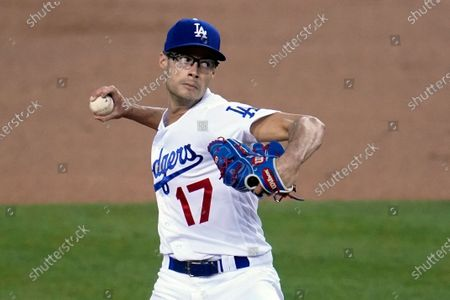 Los Angeles Dodgers starter Joe Kelly throws to an Oakland Athletics batter during the first inning of a baseball game, in Los Angeles