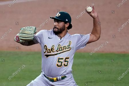 Oakland Athletics starting pitcher Sean Manaea throws to a Los Angeles Dodgers batter during the first inning of a baseball game, in Los Angeles