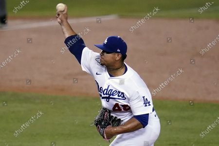 Los Angeles Dodgers relief pitcher Brusdar Graterol throws to an Oakland Athletics batter during the second inning of a baseball game, in Los Angeles