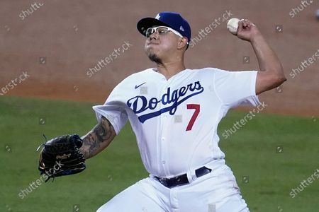 Los Angeles Dodgers reliever Julio Urias throws to an Oakland Athletics batter during the fourth inning of a baseball game, in Los Angeles