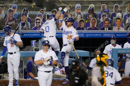 Stock Photo of Los Angeles Dodgers' Max Muncy (13) celebrates his two-run home run with Cody Bellinger (35) during the third inning of the team's baseball game against the Oakland Athletics, in Los Angeles