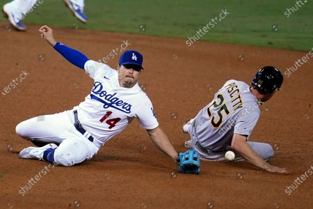 Stock Picture of Oakland Athletics' Stephen Piscotty (25) steals second base past Los Angeles Dodgers second baseman Enrique Hernandez during the ninth inning of a baseball game, in Los Angeles