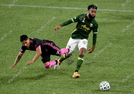 Portland Timbers midfielder Eryk Williamson, right, takes the ball from Seattle Sounders forward Raul Ruidiaz during the second half of an MLS soccer match in Portland, Ore