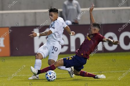 Real Salt Lake's Donny Toia (4) defends against LA Galaxy forward Cristian Pavon (10) during the second half of an MLS soccer match, in Sandy, Utah