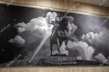 A mural depicting Breonna Taylor riding a horse in the style of a confederate monument is seen as protesters march from the Lake Merritt Amphitheater in solidarity with Louisville following a press conference by the Kentucky Attorney General announcing the grand jury's decision on September 23, 2020 in Oakland, Ca.  The Kentucky grand jury indicted one of the three officers involved in the killing of Breonna Taylor. Breonna Taylor, was fatally shot by LMPD officers during a no-knock warrant at her apartment on March 13, 2020 in Louisville,Ky.